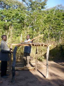Ba Bernardi and Ba Allan building an akantamba (dish rack).