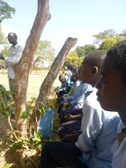 "Ba Allan Mwango teaching our Grassroots Soccer ""team"" about HIV at the Mumana Lupando Primary School."