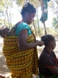 Ba Scolastica braids Ba Agatha's hair while her baby, Musonda, checks out the camerawoman.