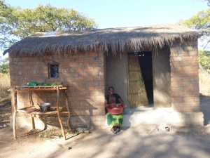 Ba Mwaba on the doorstep of her new home - originally intended to be Ba Webby's home.