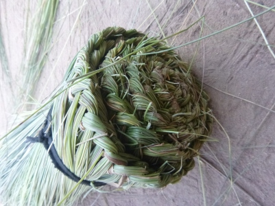 Finished broom made from wetland grasses.