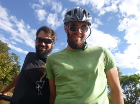 """Jesse and Dan in the truck. Dan wore his helmet for extra """"safety."""""""