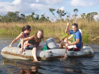 Megan, Erica, and Zach struggle along on the second boat.