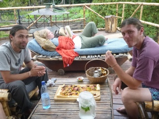 Zach and Adam enjoy the luxury of pizza while Kajsa lounges with a book.