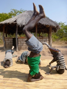 This just happened in my yard one day. Stephen, aka Bwalya, started doing head stands. Then the smaller kids all wanted to try.
