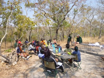Outdoor classroom: the camp listens to Ba Jonathan and Bastiaan talk about the park on our first full day.