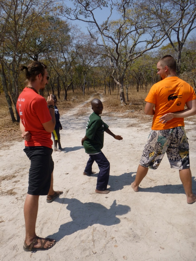 Stephen is clearly outmatched by giant PCVs Scott (left) and Cody, but he participated eagerly in every game and activity - and held his own.