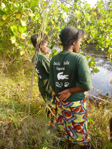 Cynthia and Gertrude looking for floating plants in the Lukulu River.
