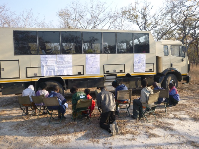So studious! I was so proud one morning to stumble upon half the camp taking studious notes from lessons the day before. This is the massive truck that took us from Kasama to the park.