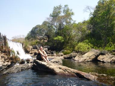 Amy sunbathing below the second half of the waterfall.