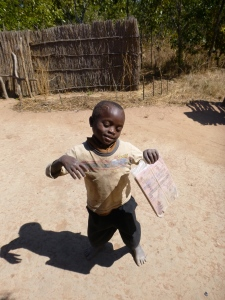 Kamfwa, dancing with his school notebook on a homework-free day.