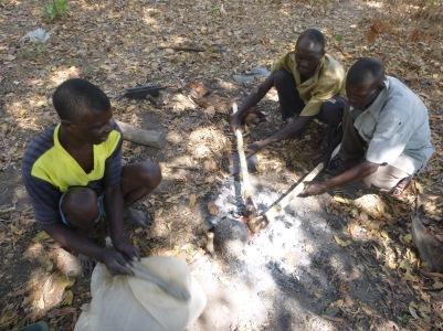 Bashi Patty, Bashi Chola, and Ba Abel burning the heads of handles to make new inkasu (hoes).
