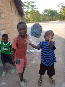 Playing with a homemade ball at the school.