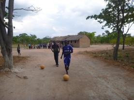 Jackson (left) and Amos trying to dribble multiple balls during our Grassroots Soccer practice.