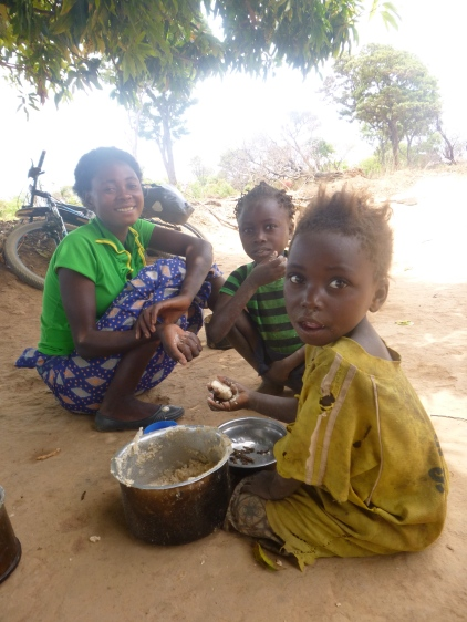 """A family that invited me to eat ubwali with them, about 70 km into my first day on the road. When I heard, """"Iseni! Tulye ubwali!"""" (""""Come here! We're eating ubwali!"""") from the side of the road, I took it as a good sign. And of course I couldn't say no."""