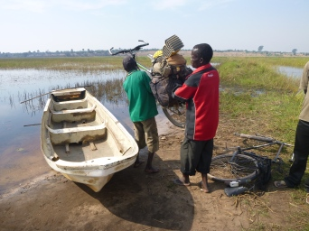 Loading up bikes onto the rowboat that would ferry us across to Kasaba. I think we had six bikes in all on that boat, plus the passengers.