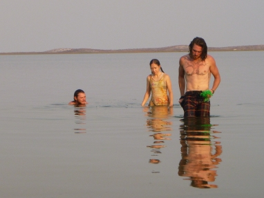 Surrealist, album-cover photo that Julie took of Adam, me, and Lucas in Lake Chifunabuli. The sand on the hills in the background looked so much like snow, it kinda killed me!
