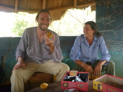 At the Luapula Provincial House in Mansa, Jacob eats his first icisongole fruit, with encouragement from Samwell.
