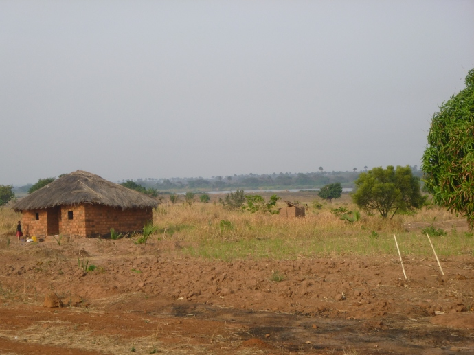 Hoes in a partly-tilled field between Mwense and Kazembe. In the distance is the Luapula River and, on the other side, the Democratic Republic of Congo.