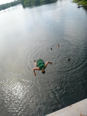 Woo hoo! Lucas does a back flip off the bridge.