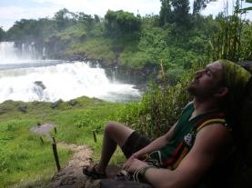 Lucas takes a nap on a rock step above Kabweluma Falls.