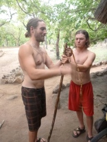 Lucas and Adam try to look manly while making a home-made spear for killing frogs. Their hunting expedition was less than spectacular.