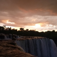Sunset and storm clouds over Lumangwe Falls on our last night there.