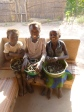 Lavenda, Norida, and Annette with their morning's caterpillar harvest.