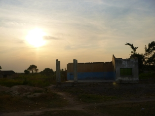 Sunset behind an abandoned building in the village of Nsombo.