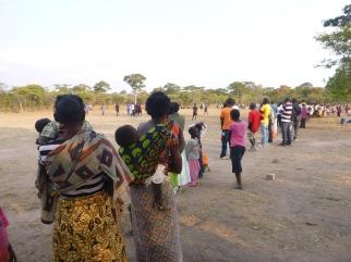 Mfubans watching a bola (football/soccer) match.