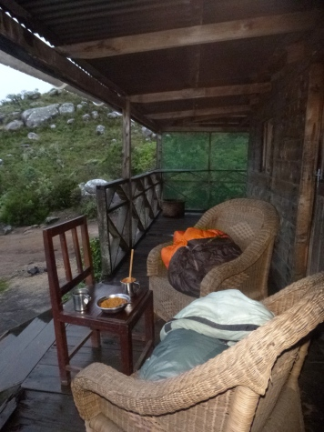 Dinner on the porch of Chisepo Hut. We wanted to be outside, but it was cold! (Hence the sleeping bags.)