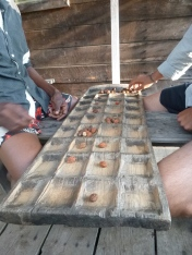 Mancala! We found this board at the Lichenya Hut and spent a lazy afternoon playing - after Ba Dennis patiently taught us the rules.
