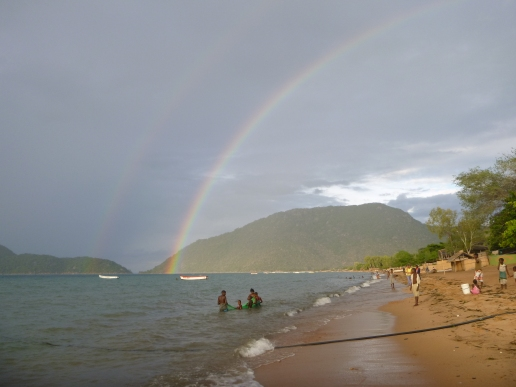 Rainbow view over Lake Malawi from Cape Maclear as locals pull in their fishing nets.