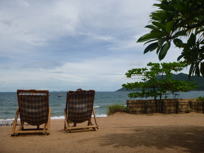 Lounge chairs on the beach.