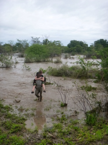 Leah paid a local guy to carry her across the flooded river to the other side of the washed-out road.