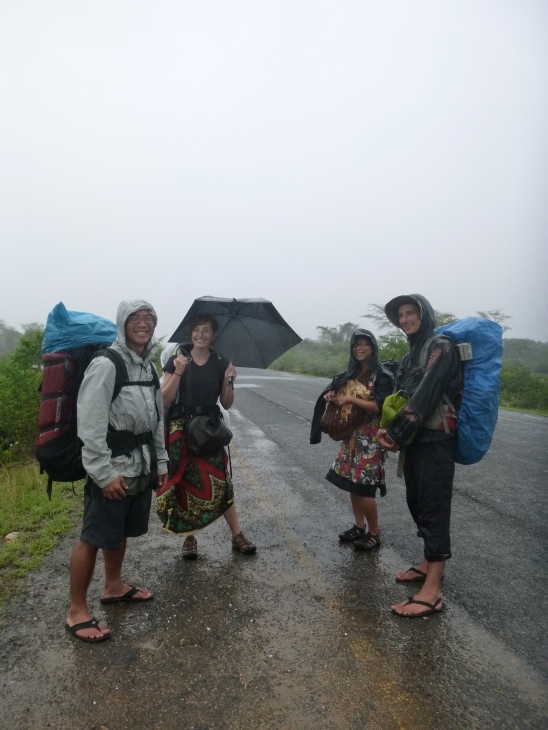 Flood refugees: stranded on the side of the road in a downpour. Isn't this what traveling's all about?