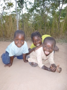Obed, left, at age five, with Maria and Cila.