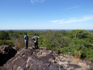 "Ba Bernardi and Ba Evans atop Mfuba's ""mountain."" You have to walk very gradually downhill to reach it. But it is beautiful."