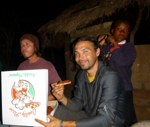At Scott's site, Adam and Zach enjoy pizza - brought in by bicycle from just 5 Km away - and hair-braiding services.
