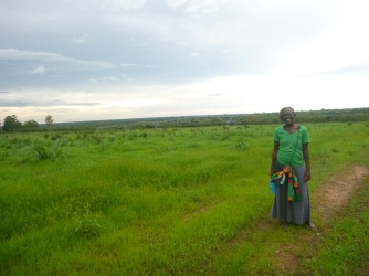 Faye, posing with the center pivot just a few kilometers from her house. Irrigated commercial farming is a rarity in Northern Province.
