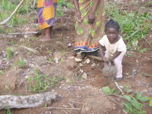 Musonda, aka Martha, isn't yet two years old but was already trying to help in the Mfuba Co-op demonstration field.