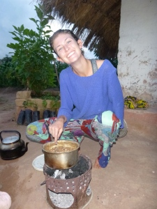 PCV Christina cooking over her charcoal brazier.