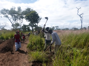 Ba Ida, Bashi Chisala, and Ba Bernardi building a new road through Mfuba.